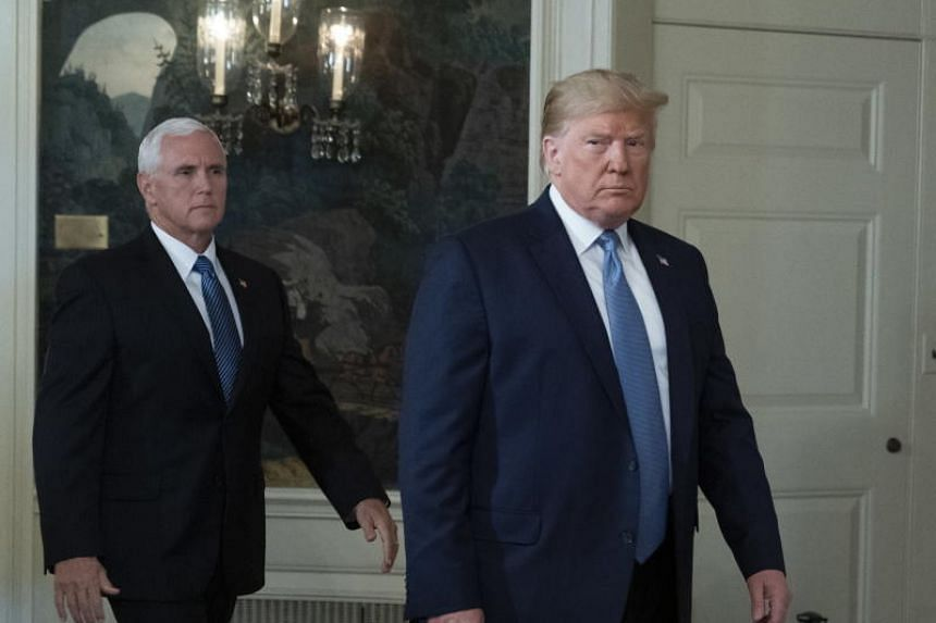 In this photo taken on Aug 5, 2019, US President Donald Trump arrives with US Vice President Mike Pence to make a statement at the White House in Washington.