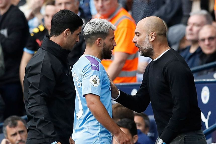 Pep Guardiola having an exchange of words with Sergio Aguero after the player was substituted. The City boss later played down the incident.