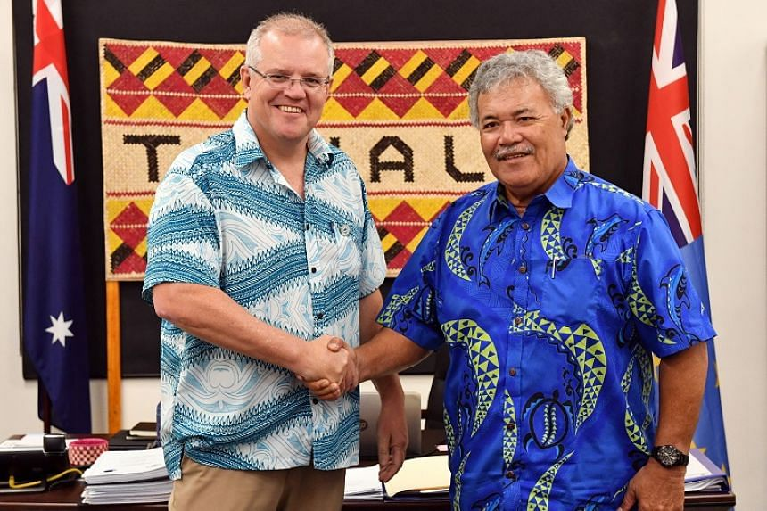 Australia's Prime Minister Scott Morrison shaking hands with Tuvalu's Prime Minister Enele Sopoaga during the Pacific Islands Forum in Funafuti, Tuvalu, on Aug 14, 2019.