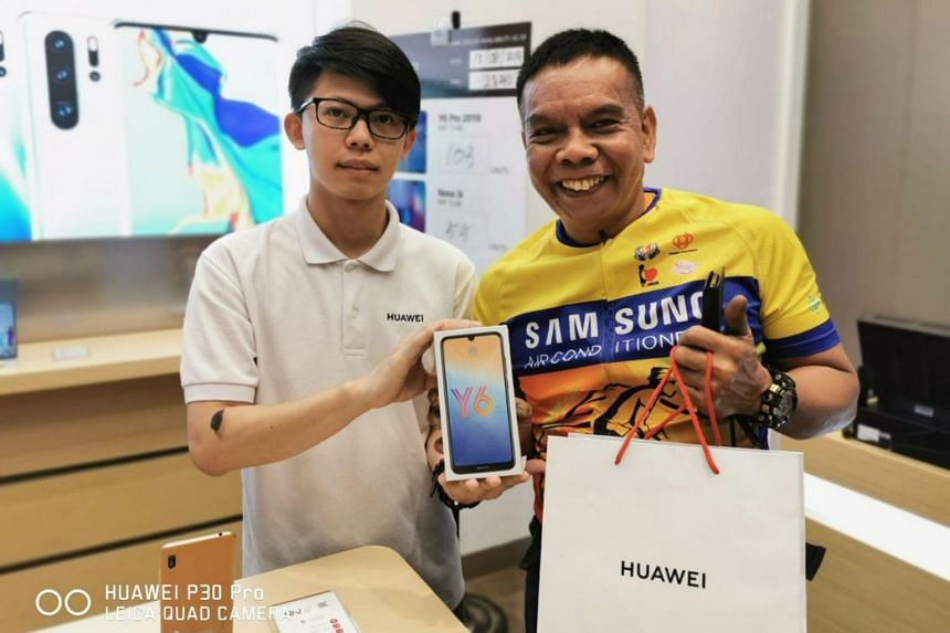 Mechanic Salehim Aman purchased a Huawei Y6 Pro with the $100 voucher given by Huawei at its concept store in Jurong Point on Aug 13.