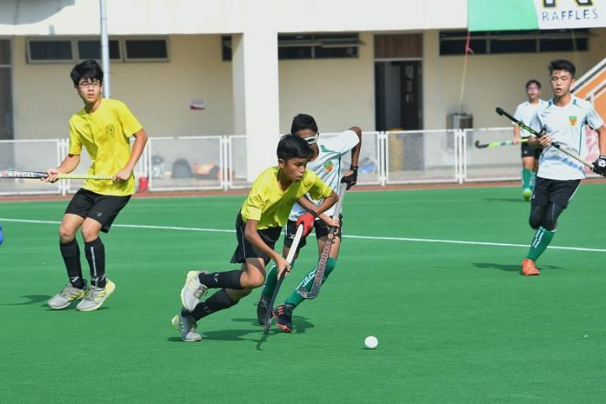 Players in action during the C Division boys' final match between Victoria School and Raffles Institution at Sengkang Hockey Stadium on Aug 19.