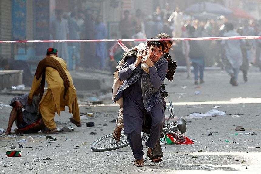 At least 66 people were injured in a series of explosions in the eastern Afghan city of Jalalabad yesterday. There was no immediate claim of responsibility. PHOTO: REUTERS