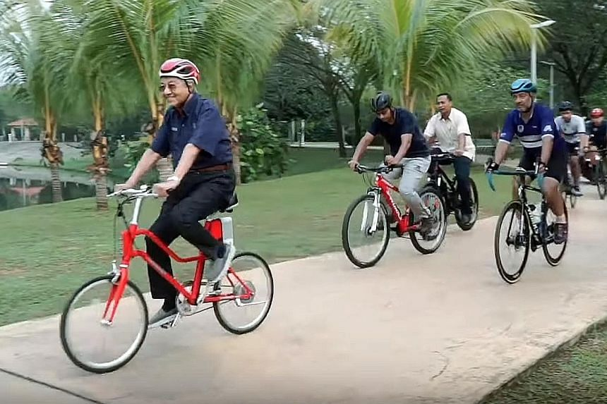 A screengrab from a video showing Malaysian Prime Minister Mahathir Mohamad cycling with an entourage of nearly 10 men around parks in Putrajaya and Cyberjaya at the weekend. Tun Dr Mahathir, who is in his second stint as premier, celebrated his 94th