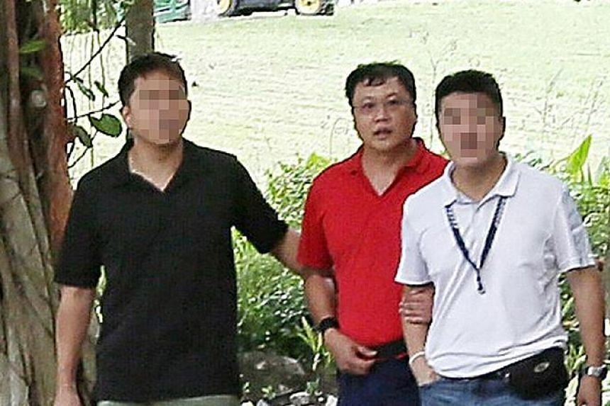 Above: Leslie Khoo Kwee Hock was convicted last month of murdering engineer Cui Yajie. Left: Khoo (in red) being taken by plainclothes police officers in 2016 to an area near Gardens by the Bay where he strangled the 31-year-old. He later burned her