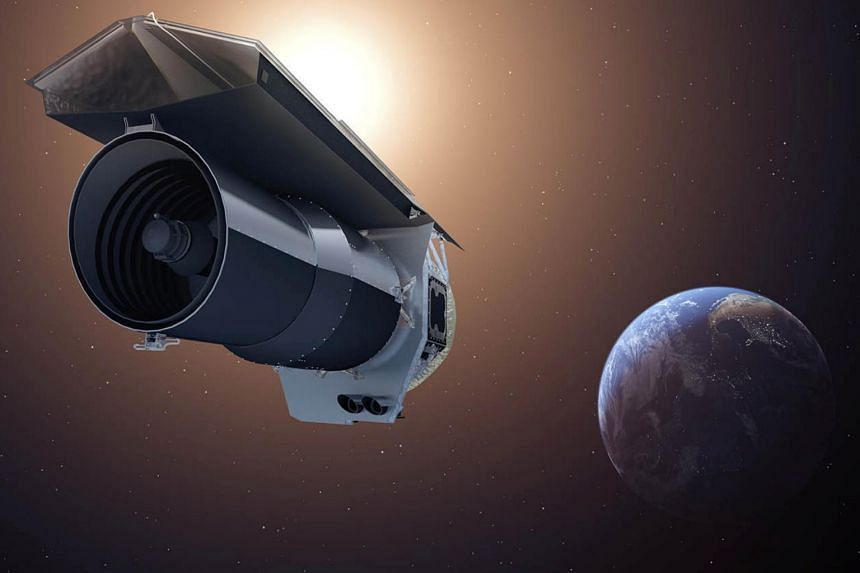 """An artist's conception shows Nasa's Spitzer Space Telescope as it begins its """"Beyond"""" mission phase on Oct. 1, 2016."""