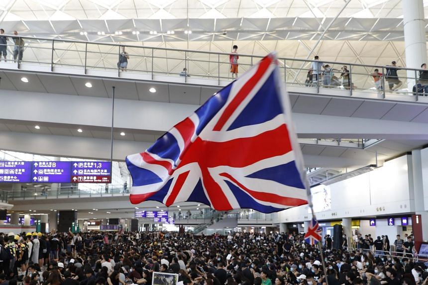 A protester waving a British flag during a demonstration at Hong Kong airport, on Aug 9, 2019.