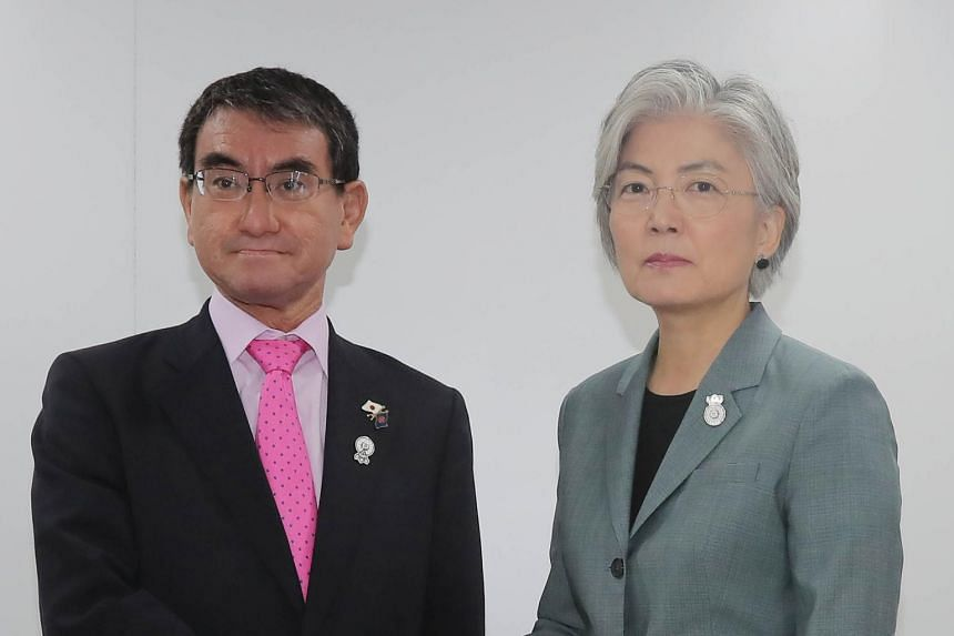In a picture from Aug 1, 2019, South Korea's Foreign Minister Kang Kyung-wha (right) meets with her Japanese counterpart Taro Kono on the sidelines of the Association of Southeast Asian Nations (ASEAN) foreign ministers' meeting in Bangkok.