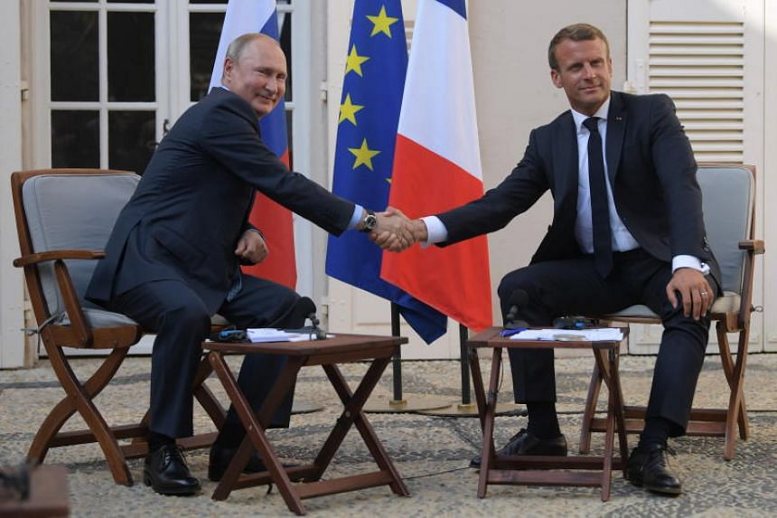 Russian President Vladimir Putin (left) and French President Emmanuel Macron attend a joint press conference before the talks at the fort of Bregancon in France, on Aug 19, 2019.