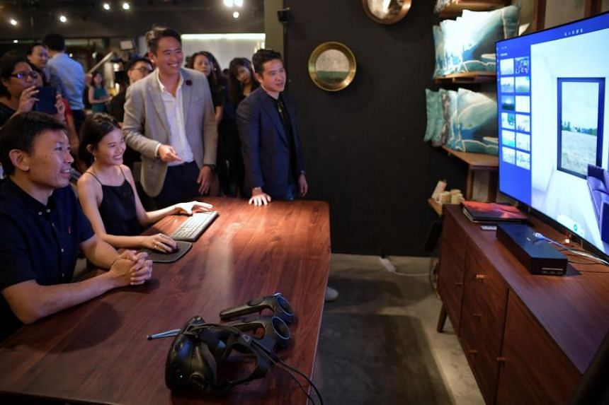 Senior Minister of State for Trade and Industry Chee Hong Tat (left) during a visit to furniture store Commune on Aug 20, 2019. Commune is launching a new augmented reality app for customers.