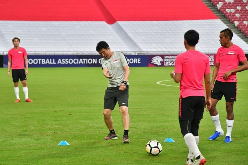 National football coach Tatsuma Yoshida with the Lions during a training session at the National Stadium on June 10, 2019.