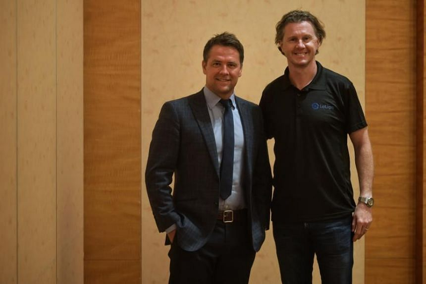 Michael Owen and Steve McManaman on the sidelines of a partnership signing ceremony between the Spanish La Liga and licensed crypto token exchange brand GCOX at Marina Bay Sands Expo and Convention Centre on Aug 20, 2019.