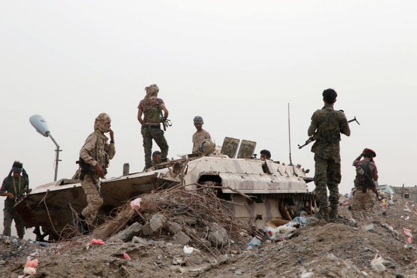 Members of UAE-backed southern Yemeni separatist forces stand by a military vehicle during clashes with government forces in Aden, Yemen, on Aug 10.