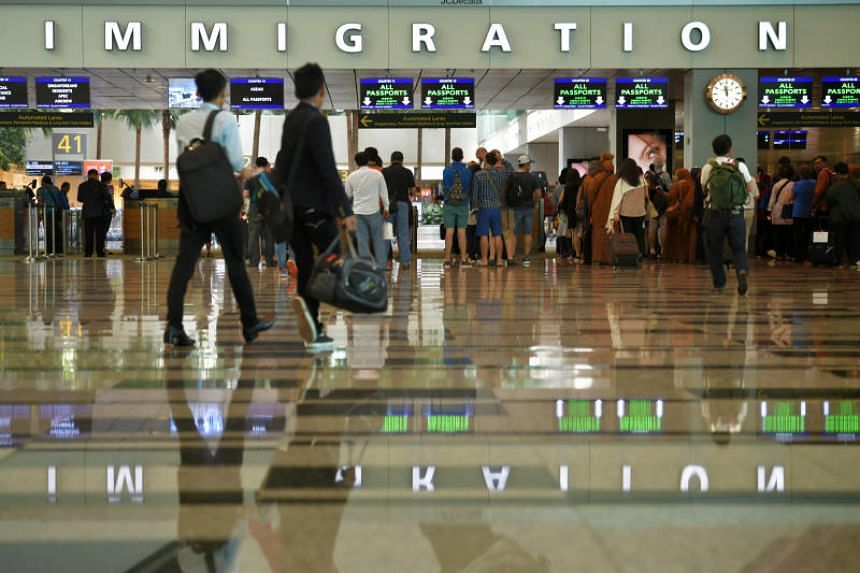 Travellers at the immigration checkpoint of the Changi Airport Terminal 3 arrival hall on March 6, 2017. On April 9, 2019, the police were alerted to a man carrying cash of more than $20,000 at the arrival hall of Changi Airport Terminal 3.