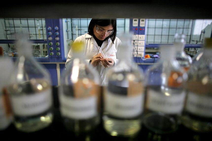 In a picture taken on Jan 17, 2007, a scientist performs chemical tests at a research and development center at Ranbaxy Laboratories in Gurgaon, India.