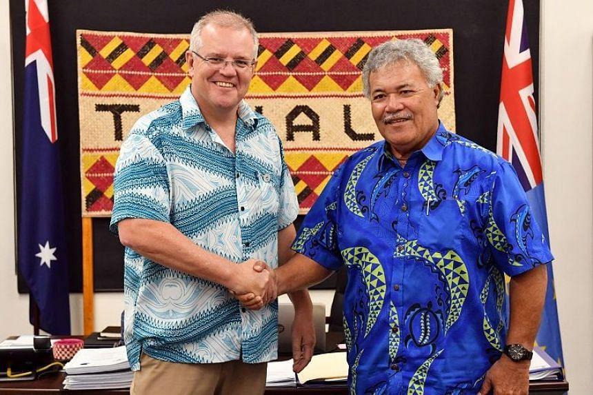 Australia's Prime Minister Scott Morrison shaking hands with Tuvalu's Prime Minister Enele Sopoaga during the Pacific Islands Forum in Funafuti, Tuvalu, on Aug 14, 2019.
