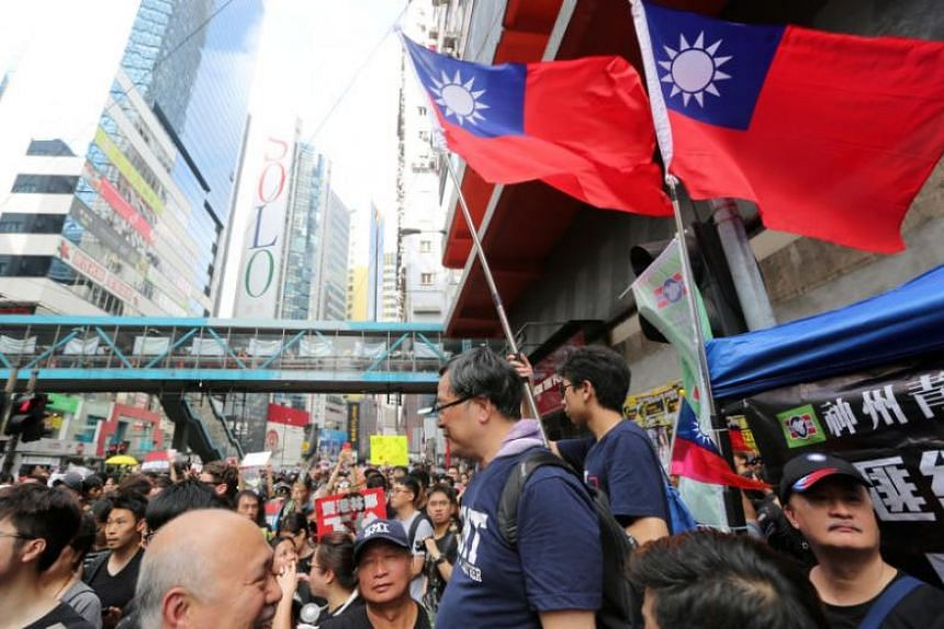 Protesters with Taiwan flags during a demonstration in Hong Kong on June 16, 2019.