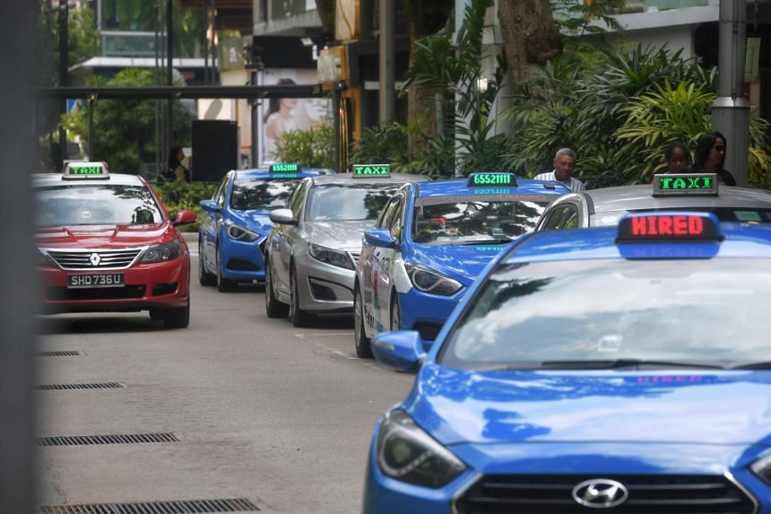 Taxis waiting for passengers at Lucky Plaza, on Aug 7, 2019.