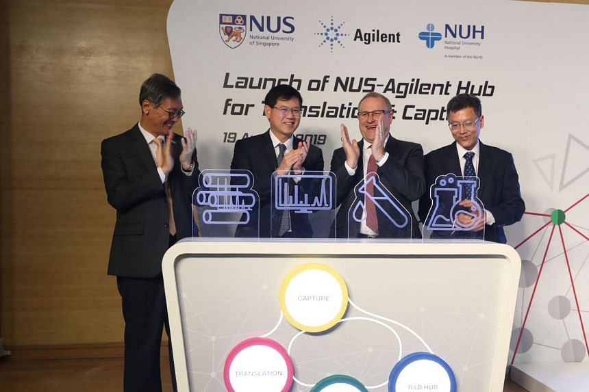 (From far left) Professor Tan Eng Chye, president of National University of Singapore; Associate Professor Benjamin Ong, the Ministry of Health's director of medical services; Mr Mike McMullen, president and chief executive of Agilent Technologies; a