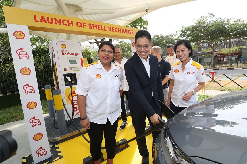 Shell's retail general manager Aarti Nagarajan, Economic Development Board managing director Chng Kai Fong and Ms Aw Kah Peng, chairman of Shell companies in Singapore, launching Shell's first electric vehicle charger in Singapore yesterday at the Du