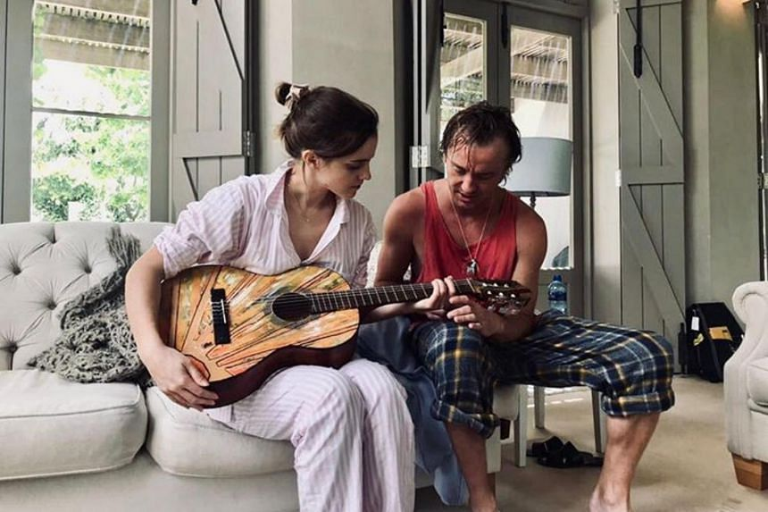 In the picture posted by Tom Felton, he is seen teaching Emma Watson to play the guitar and the former co-stars are in pyjamas.