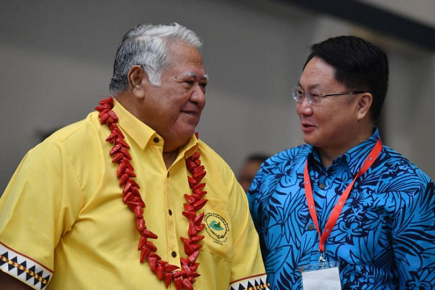 Samoan Prime Minister Tuilaepa Aiono Sailele Malielegaoi and China's special envoy for the Pacific Islands Forum Wang Xuefeng at the Forum Dialogue Partners Meeting, held as part of the Pacific Islands Forum, in Funafuti on Aug 16.