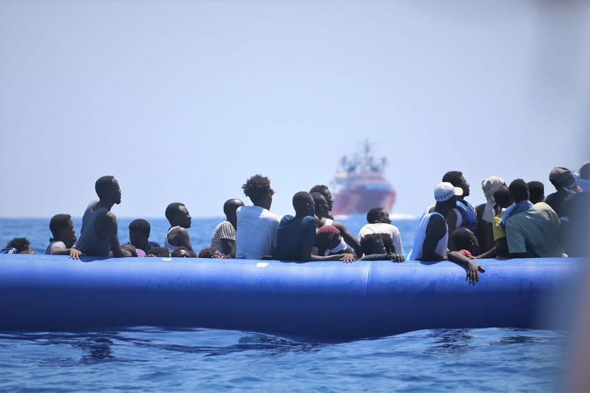 An Aug 12, 2019 photo shows migrants in a rubber dinghy awaiting rescue off the coast of Libya.