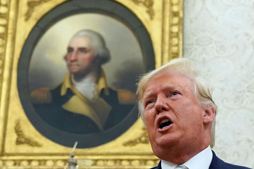With a painting of George Washington in the background, Trump speaks during his meeting with Romania's president Klaus Iohannis.