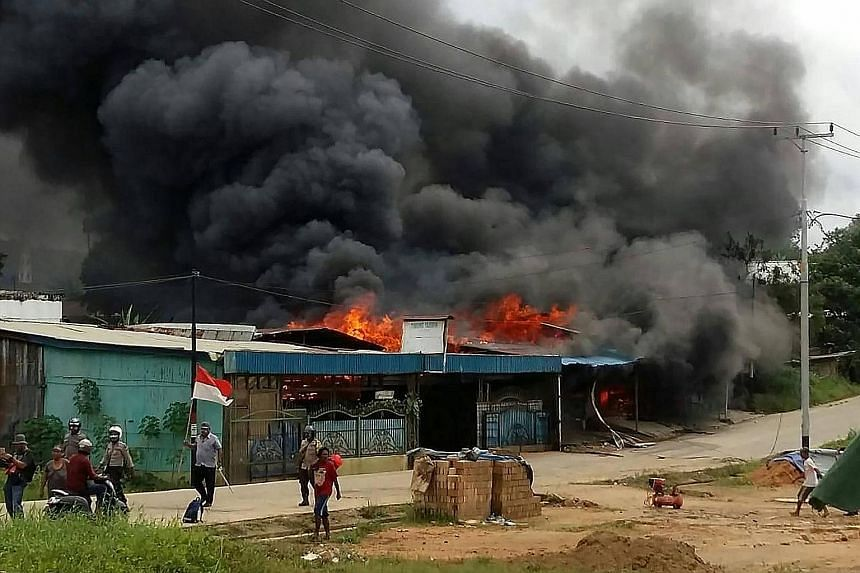 Rioting demonstrators also set fire to other buildings in Sorong city, in West Papua, yesterday. PHOTO: AGENCE FRANCE-PRESSE