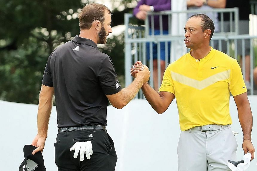 Tiger Woods (right) greeting fellow American Dustin Johnson at the BMW Championship last week. Both will be at the Presidents Cup in December, when Woods will skipper the US team.