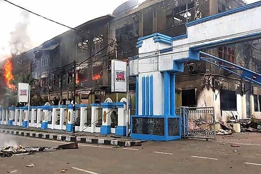 A burnt-out building in Sorong, West Papua, yesterday after it was set on fire by rioting demonstrators. The protests in West Papua were triggered by reports that the authorities had tear-gassed and detained 43 Papuan university students in Surabaya,