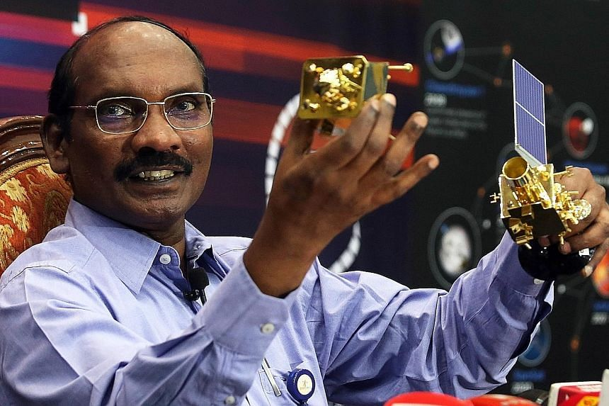 Chairman of the Indian Space Research Organisation K. Sivan using a model of the country's first moon probe to explain the lunar orbit insertion manoeuvre at Isro's headquarters in Bangalore yesterday. PHOTO: EPA-EFE