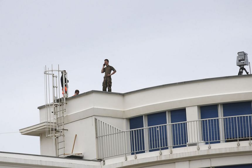 A soldier stands on the roof of the Casino Bellevue, a venue for the upcoming G-7 summit.