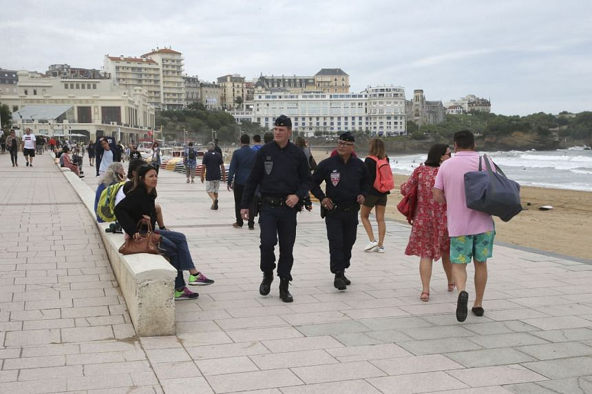 Riot police officers patrol the beach ahead of the upcoming G-7 summit in Biarritz.