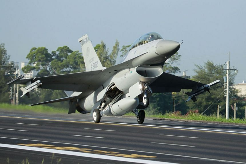 In a 2014 photo, a Taiwan Air Force F-16 fighter jet lands on a closed section of highway during a military exercise.