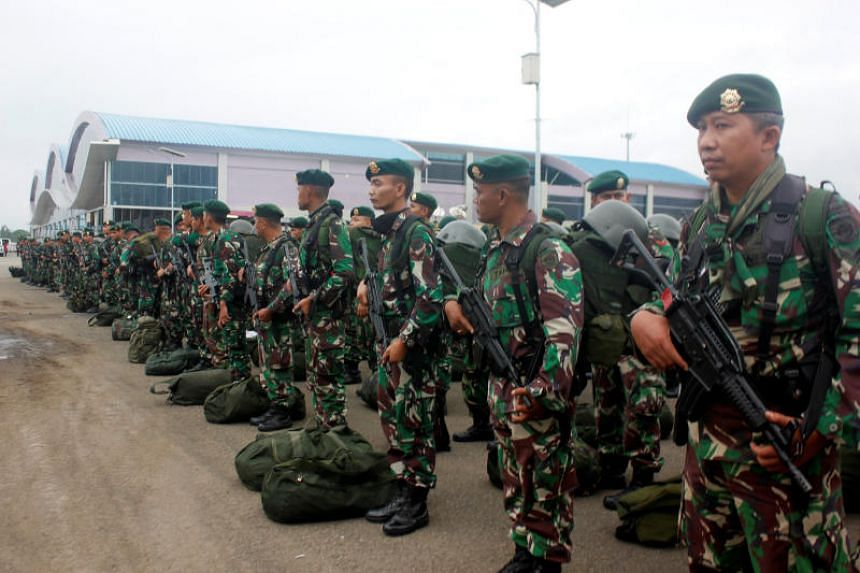 In a photo taken on Aug 20, 2019, Indonesian soldiers stand as they arrive at Domine Eduard Osok Airport to be deployed to Sorong and Manokwari following the protests in Sorong, West Papua in Indonesia.