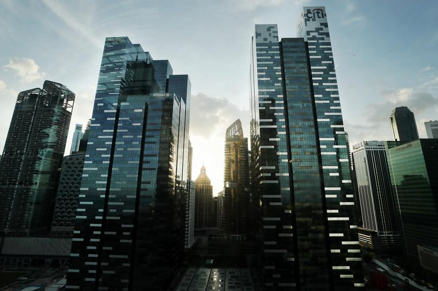 Buildings in Singapore's central business district. In a survey, about 70 per cent of the firms said they are facing the challenge of rising business costs.
