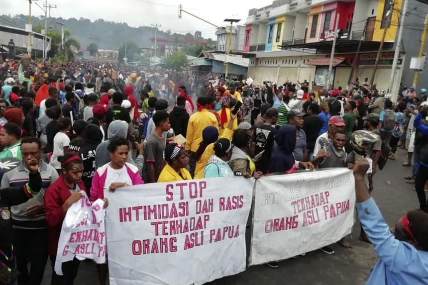 "In a photo taken on Aug 19, 2019, people display banners that read ""Stop intimidation and racism towards indigenous Papuans"" during a protest in Manokwari, Papua province, Indonesia."
