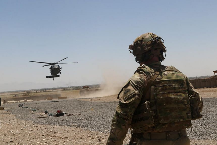 A US soldier watches as a Blackhawk Helicopter prepares to land during a mission in south-eastern Afghanistan, on Aug 4, 2019.