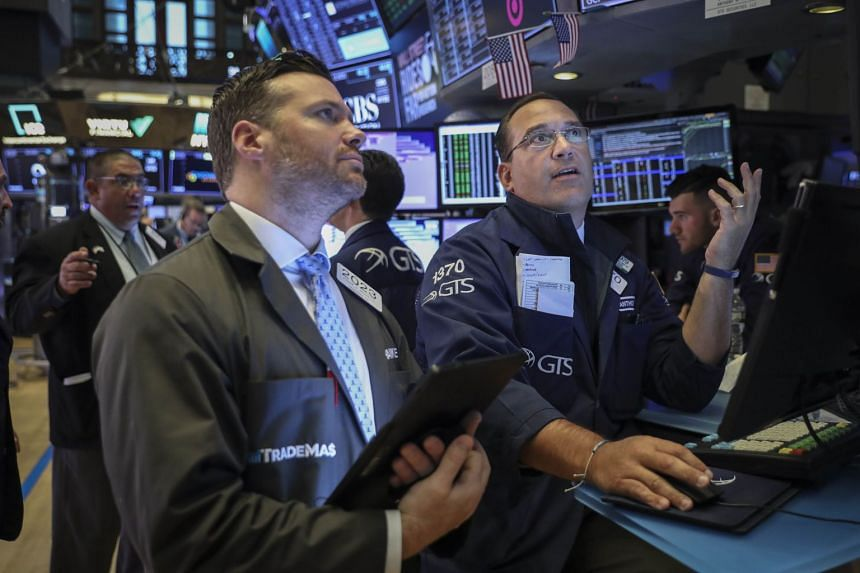 An Aug 19, 2019 photo shows traders working on the floor of the New York Stock Exchange.