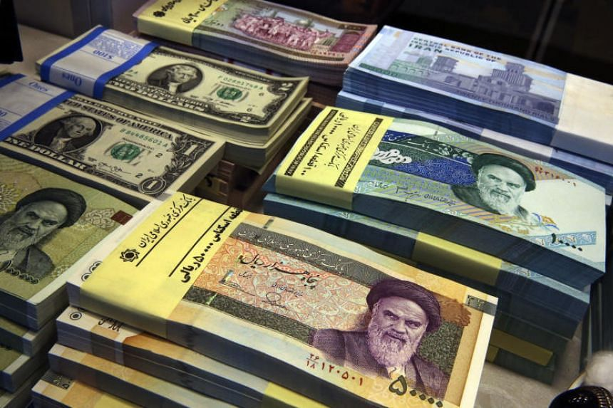 If passed by Parliament and approved by lawmakers, Iran's Central Bank would in effect devalue the Islamic Republic's sanctions-battered currency, the rial, and rename it toman.
