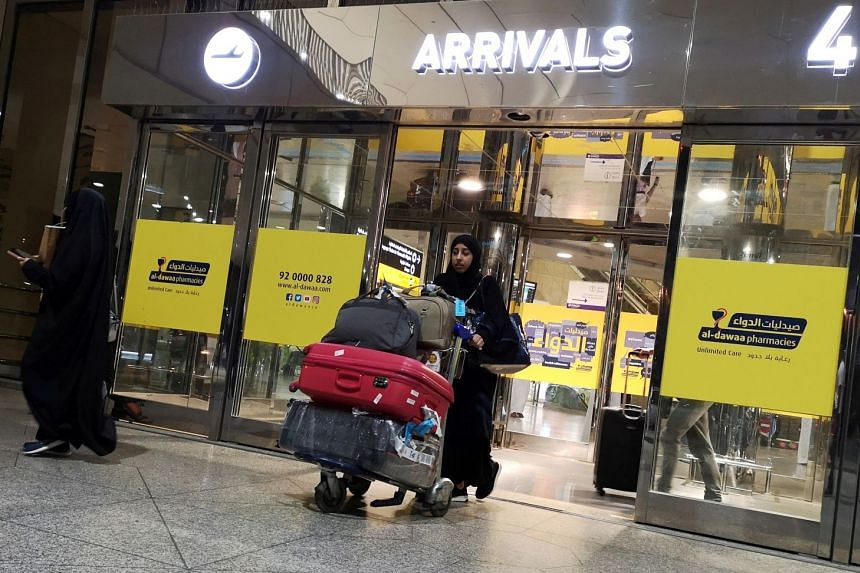 A Saudi woman arrives at King Fahd International Airport in Dammam, Saudi Arabia.