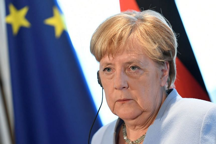 Angela Merkel attends a joint news conference with Dutch Prime Minister Mark Rutte in The Hague.