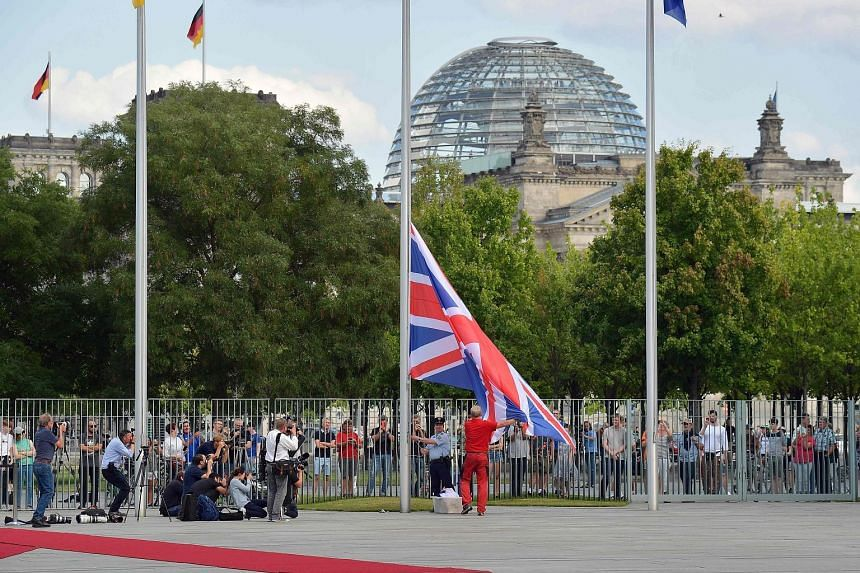 The Union Jack being raised ahead of the visit of British Prime Minister Boris Johnson at the Chancellery in Berlin yesterday. Mr Johnson is visiting Berlin to kick off a marathon of tense talks with key European and international leaders as the thre