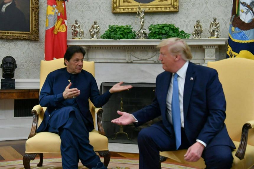 In a photo taken on July 22, 2019, US President Donald Trump and Pakistani Prime Minister Imran Khan (left) gesture during a meeting in the Oval Office at the White House in Washington, DC.