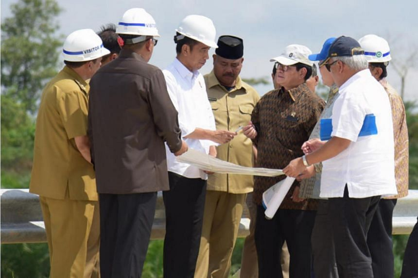 In a picture from May 2, 2019, Indonesia President Joko Widodo and other officials survey a possible site for a new Indonesian capital at Bukit Soeharto, in Indonesia's East Kalimantan province.