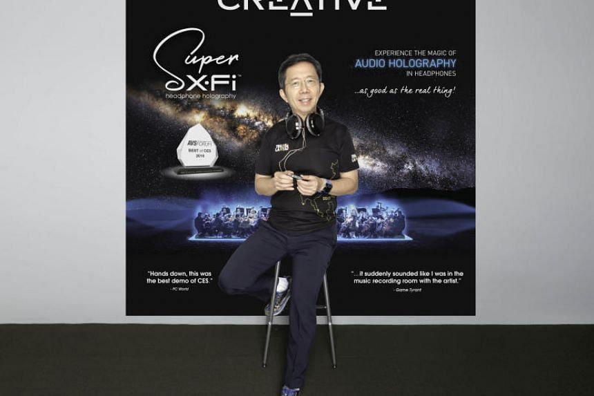 Sim Wong Hoo, the founder, CEO and chairman of Creative Technology with the company's Super X-Fi headphone processor.
