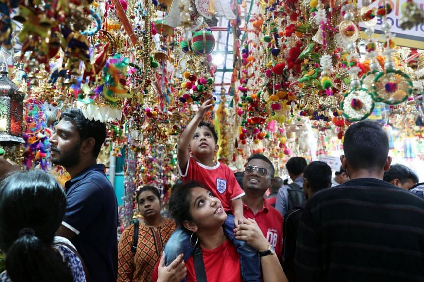 In a photo taken on Nov 5, 2018, safety officer Mr Arunan Ulaganathan and his family soak up the Deepavali festivities at Campbell Lane, Little India.