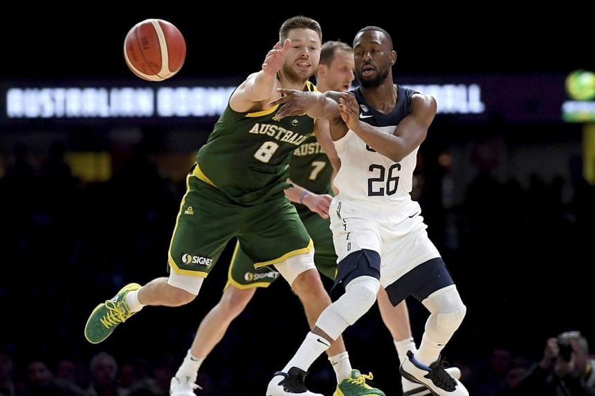 United States' Kemba Walker (right) and Australia's Matthew Dellavedova battle for the ball during their exhibition basketball game in Melbourne on Aug 22, 2019.