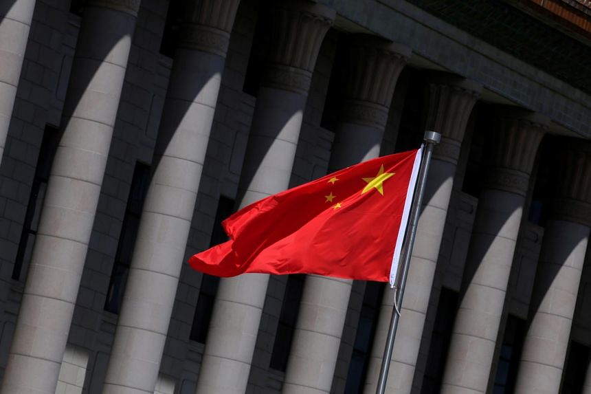 In a photo taken on May 27, 2019, a Chinese flag flutters in front of the Great Hall of the People in Beijing, China.