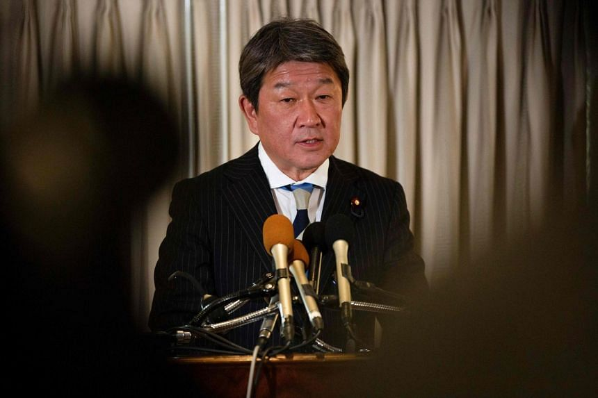 In a photo taken on on Aug 2, 2019, Japan Economy Minister Toshimitsu Motegi speaks at a press conference at a hotel in Washington, DC.